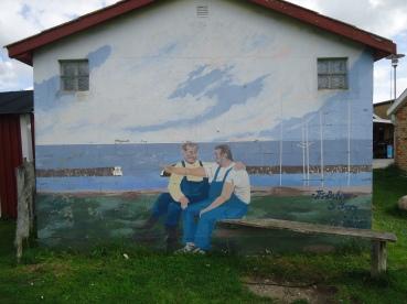 Painting of two old men in Kivik